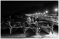 Long tail boats and pier at night, Ko Phi Phi. Krabi Province, Thailand (black and white)