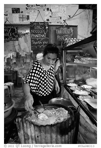 Woman preparing Pad Thai, Phi-Phi island. Krabi Province, Thailand (black and white)