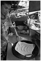 Man preparing thai pancake, Tonsai village, Ko Phi Phi. Krabi Province, Thailand (black and white)