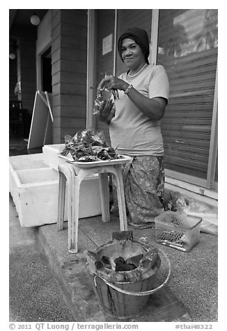 Woman selling grilled seafood, Tonsai village, Ko Phi-Phi island. Krabi Province, Thailand (black and white)