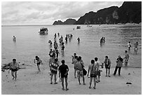 Beach with tourists arriving, Phi-Phi island. Krabi Province, Thailand (black and white)