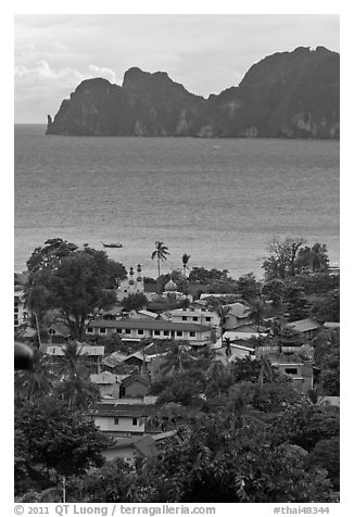 Village, bay and cliffs, Ko Phi-Phi island. Krabi Province, Thailand (black and white)