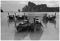 Tranquil waters of Ao Lo Dalam bay with longtail boats, Phi-Phi island. Krabi Province, Thailand ( black and white)