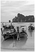 Long tail boats in serene waters of Lo Dalam bay, Ko Phi-Phi island. Krabi Province, Thailand (black and white)