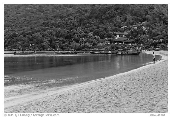 Man standing alone on beach, Ao Lo Dalam, Phi-Phi island. Krabi Province, Thailand (black and white)