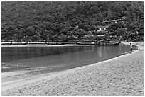 Man standing alone on beach, Ao Lo Dalam, Phi-Phi island. Krabi Province, Thailand ( black and white)