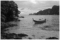 Boat, clear water, stormy skies, Phi-Phi island. Krabi Province, Thailand (black and white)