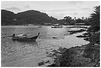 Long tail boat, and Tonsai village, Ko Phi-Phi Don. Krabi Province, Thailand (black and white)