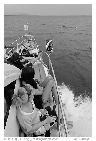 Women sitting on front of boat. Krabi Province, Thailand (black and white)