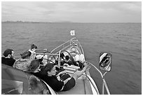 Passengers on prow of boat. Krabi Province, Thailand (black and white)