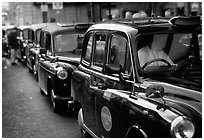 Black London cabs. London, England, United Kingdom ( black and white)