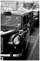 Black London taxis. London, England, United Kingdom (black and white)