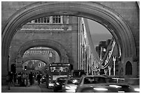 Arches and car traffic on the Tower Bridge at nite. London, England, United Kingdom (black and white)
