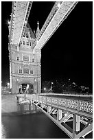 North Tower and upper walkway of the London Bridge at night. London, England, United Kingdom (black and white)