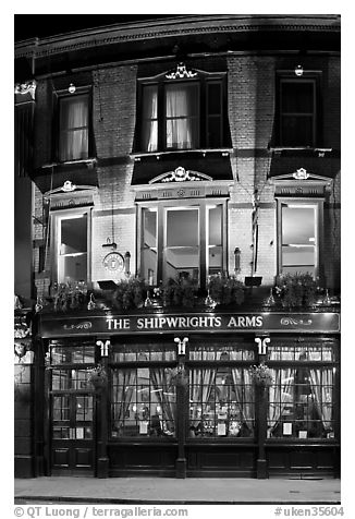 Building housing the pub Shipwrights Arms at night. London, England, United Kingdom (black and white)