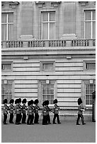 Guards marching during the changing of the Guard, Buckingham Palace. London, England, United Kingdom (black and white)