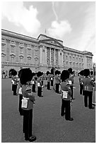 Guards and Buckingham Palace, the changing of the Guard. London, England, United Kingdom (black and white)