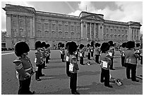Rows of guards  wearing bearskin hats and red uniforms. London, England, United Kingdom (black and white)