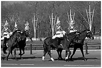 Horse guards riding near Buckingham Palace. London, England, United Kingdom (black and white)