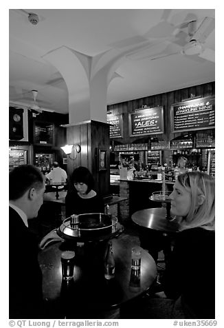 Talking around a drink in the pub Westmister Arms. London, England, United Kingdom (black and white)