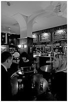 Talking around a drink in the pub Westmister Arms. London, England, United Kingdom ( black and white)