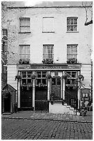 Pub the Grenadier, and cobblestone mews. London, England, United Kingdom ( black and white)