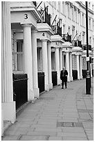 Businessman walking down near townhouses crescent. London, England, United Kingdom (black and white)