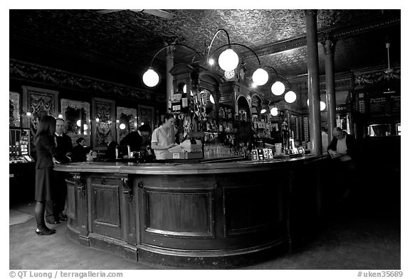 Central horseshoe bar in the 19th century victorian  pub Princess Louise. London, England, United Kingdom (black and white)