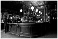 Central horseshoe bar in the 19th century victorian  pub Princess Louise. London, England, United Kingdom ( black and white)