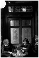 Young men, beer pints, and etched glass, pub Princess Louise. London, England, United Kingdom (black and white)
