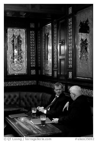Business men talking over a beer, Victorian boozer Princess Louise. London, England, United Kingdom (black and white)