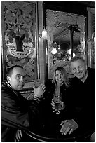 Friends cheering up with a beer in front of echted glass and fine tiles of pub Princess Louise. London, England, United Kingdom (black and white)
