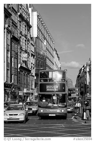 Double decker busses in a busy street. London, England, United Kingdom