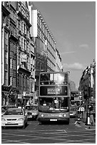 Double decker busses in a busy street. London, England, United Kingdom ( black and white)