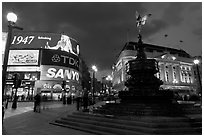 Neon advertising and Eros statue, Piccadilly Circus. London, England, United Kingdom (black and white)