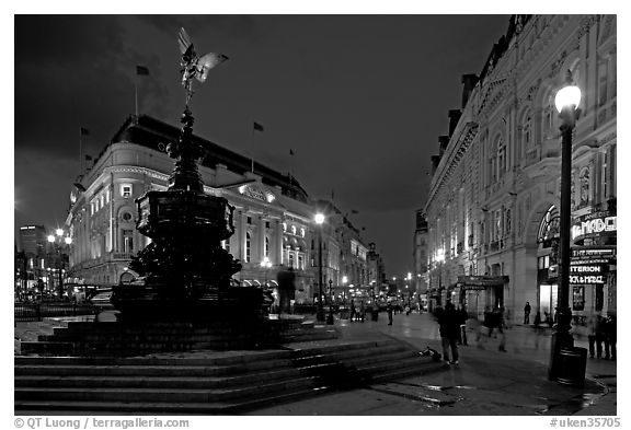 Eros statue and streets at dusk, Picadilly Circus. London, England, United Kingdom (black and white)