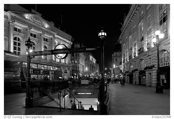 Underground station entrance at dusk, Piccadilly Circus. London, England, United Kingdom (black and white)
