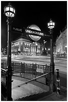 Underground  entrance and lights from traffic at night, Piccadilly Circus. London, England, United Kingdom (black and white)