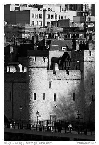 Tower of London and jumble of modern buildings in the background. London, England, United Kingdom (black and white)