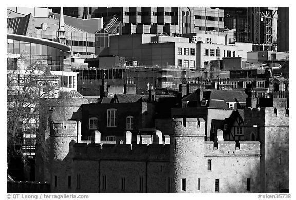 Tower of London and modern buildings. London, England, United Kingdom (black and white)
