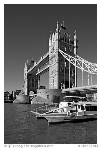 Catamaran below Tower Bridge. London, England, United Kingdom (black and white)