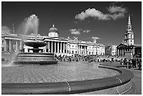 Fountain, National Gallery, and  St Martin's-in-the-Fields church, Trafalgar Square. London, England, United Kingdom (black and white)