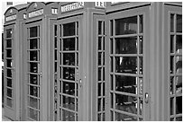Row of Red phone booths. London, England, United Kingdom ( black and white)