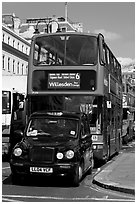 Taxi and double decker bus. London, England, United Kingdom (black and white)