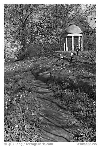Children running down a trail leading to gazebo. Kew Royal Botanical Gardens,  London, England, United Kingdom