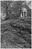 Children running down a trail leading to gazebo. Kew Royal Botanical Gardens,  London, England, United Kingdom (black and white)