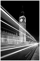 Lights from a moving bus, Houses of Parliament, and Big Ben at night. London, England, United Kingdom (black and white)