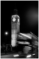 Double-decker bus in motion and Big Ben at night. London, England, United Kingdom ( black and white)