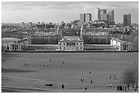 Greenwich Park lawn, Royal Maritime Museum, Greenwich Hospital, and Docklands. Greenwich, London, England, United Kingdom (black and white)