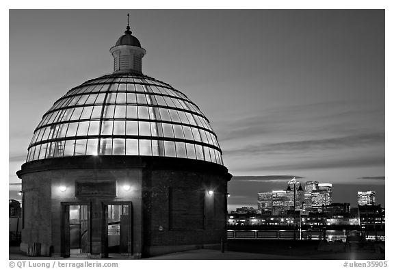 Entrance of foot tunnel under the Thames and Docklands buildings at dusk. Greenwich, London, England, United Kingdom (black and white)
